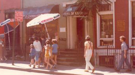People Walking in Front of the Restaurant